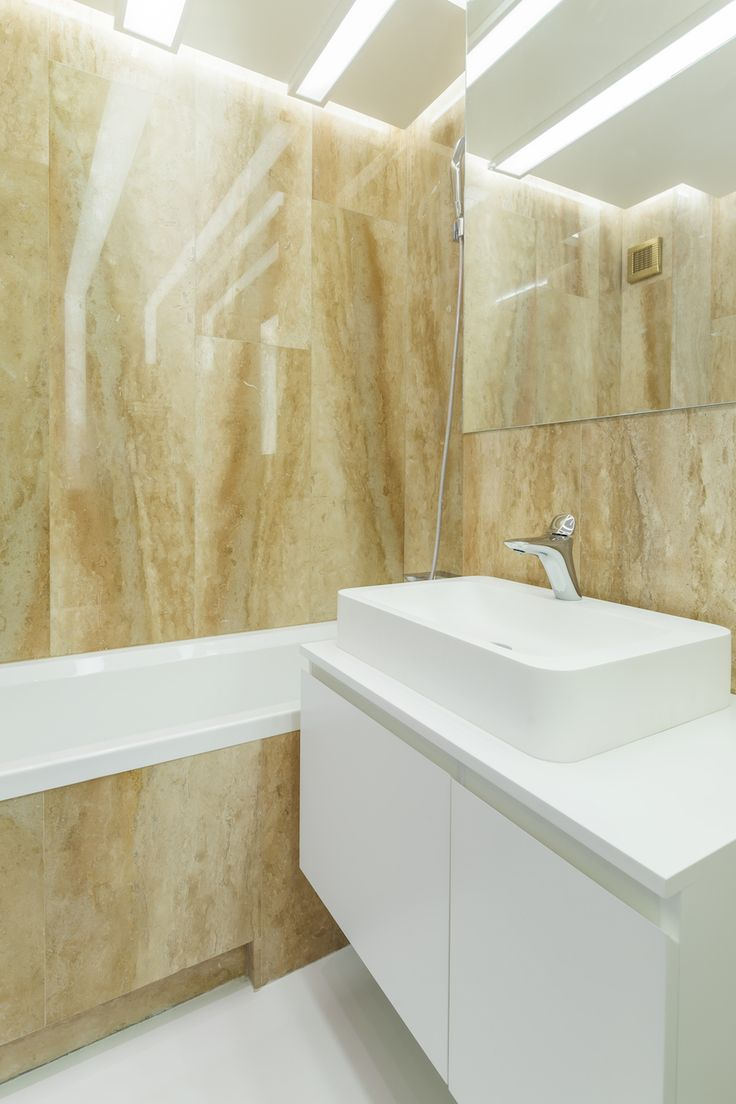minimalist bathroom, natural stone walls, white matte MDF cabinet, hidden wall storages with mirrored fronts   orders/price offers at: office@liniafurniture.ro