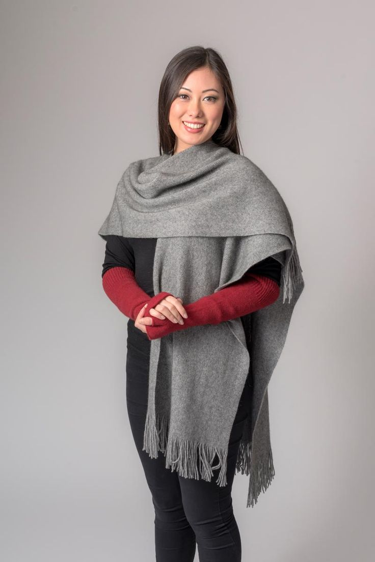 This silver grey possum merino wrap is made from two scarves joined together half way up and is so versatile. It looks even better teamed with contrasting short or long wrist warmers. Wear this wrap with one or both sides flung across your shoulders, or with a belt. The length at the back hangs below your bottom and is very flattering.
