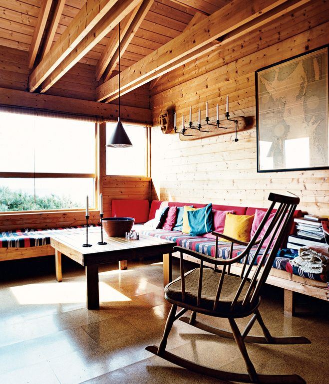 Built-in benches function both as seating and as spare beds in the living room. Holm says the striped, hand-woven fabric she found in Greece is indestructible, and the cork flooring throughout the house has gone 40 years without needing replacing.  Photo by Pia Ulin.