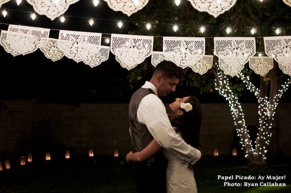 "These Papel Picado banners remind me of the lavish Sicilian weddings a la ""The Godfather"". Wonderfully classic and breathtaking paired with globe lights // Found @Yreina Ortiz on Etsy"