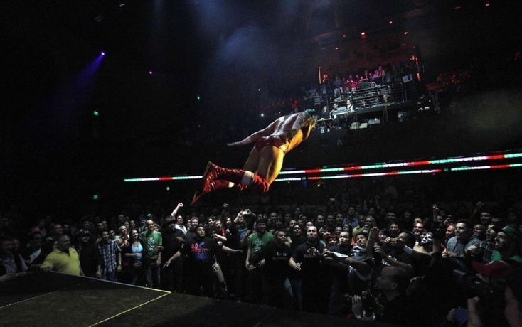 A Lucha libre wrestler leaps into the audience during the Lucha VaVOOM show as part of a Cinco de Mayo celebration at the Mayan theatre in Los Angeles, California May 5, 2013. (Mario Anzuoni/Reuters)