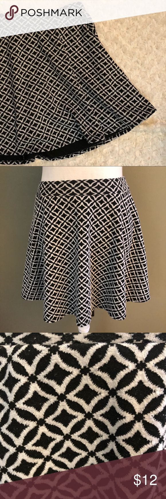 """Joe B Skater Skirt Flirty and sweet! This pattern stands out in the best way possible. Great with leggings and heels.   Measurements are taken flat and an approximation: Length: 15.5"""" Waist: 13"""" Circumference: 72""""  Please feel free to ask questions or make an offer! Joe B Skirts Circle & Skater"""
