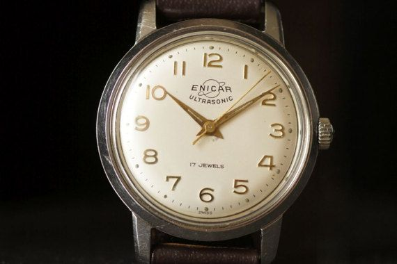 Enicar is a historic Swiss watch brand dating to 1914. The company was founded in Las Chaux-de-Fonds Switzeland when Artiste Racine spelled his name backward and created a timeless brand that has been recognized for its high quality in over 90 years.  This stunning Swiss vintage watch comes from 1960s. The mechanical 17 Jewels movement cal. AR 1010 works and keeps time well. The beautiful creamy dial has a gold Arabic numbers indexes. The crystal and the stainless steel case are in a good…