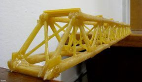 A photograph shows a student-created truss-type bridge structure made with dry spaghetti noodles glued together.
