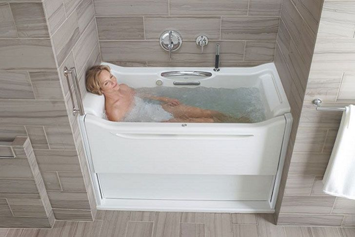 Kohler S Walk In Bathtub Features A Sliding Wall That Makes