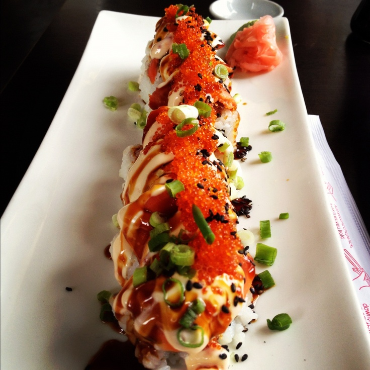 Fighting Buddha Albacore tuna, salmon and avocado. Topped with tempura tamago, Iox, yin yang sauce, tobiko, sesame seeds and green onions @ Firehouse Grill - Nanaimo BC