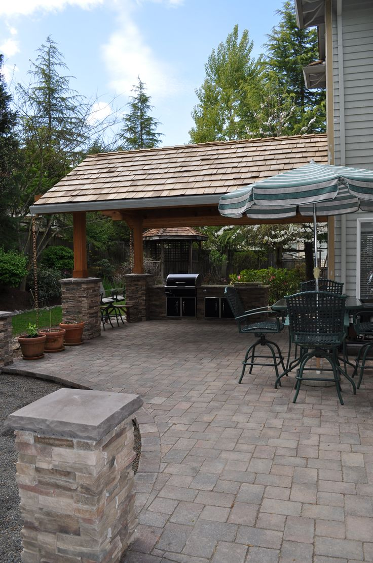 Attached roof with paver patio and cultured stone columns for Patios portland oregon