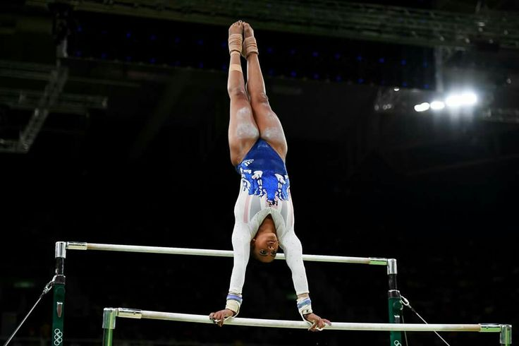 RIO DE JANEIRO, BRAZIL - AUGUST 09: Elissa Downie of Great Britain competes on the uneven bars during the Artistic Gymnastics Women's Team Final on Day 4 of the Rio 2016 Olympic Games at the Rio Olympic Arena on August 9, 2016 in Rio de Janeiro, Brazil. (Photo by Laurence Griffiths/Getty Images)