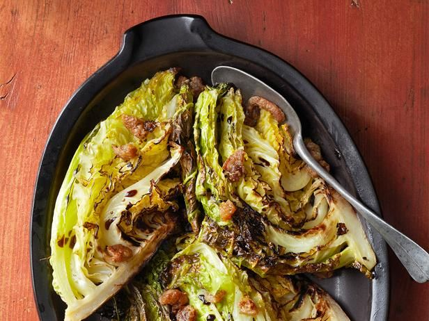 The savory cabbage in this dish is first seared then roasted and topped with tangy balsamic vinegar.