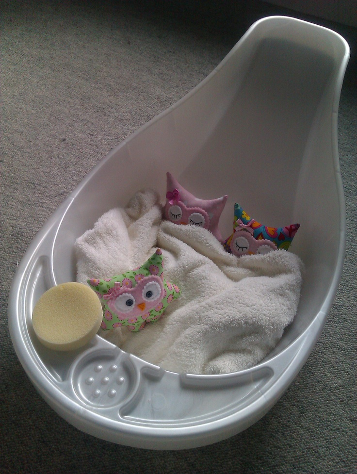 All snuggled up in the baby bath :)