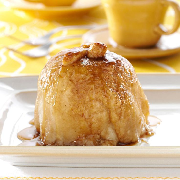 Apple Dumplings with Sauce Recipe -These warm and comforting apple dumplings are incredible by themselves or served with ice cream. You can decorate each dumpling by cutting 1-inch leaves and a 1/2-inch stem from the leftover dough. —Robin Lendon, Cincinnati, Ohio