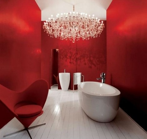 Super modern, sleek design... Who can resist? The red is inviting. The chandelier is extraordinary. And the shiny white tub makes us feel clean just looking at it. Love it! Plus - the Panton Heart Cone Chair :)