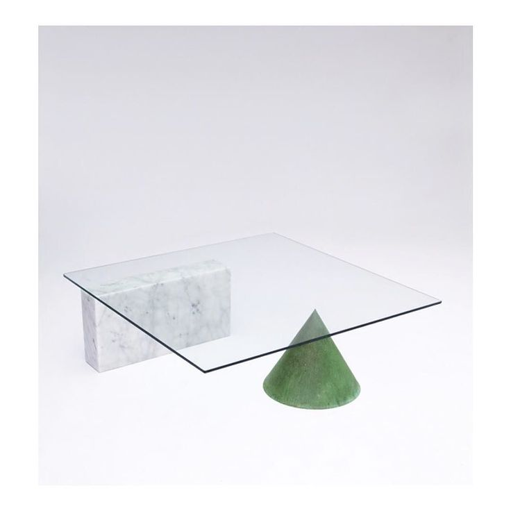 A 1984 Kono Coffee Table The Kono Coffee Table Has A Glass Top Resting On A  Slab Of Granite On One Side And The Tipof A Metal Cone ...