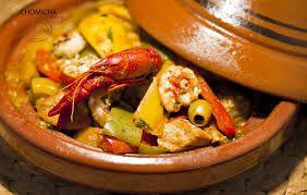 Een heerlijk slank recept: een Marokkaanse tajine van zalm, garnalen en groente. Slank qua calorieën, dus deze tajine past perfect in een dieet