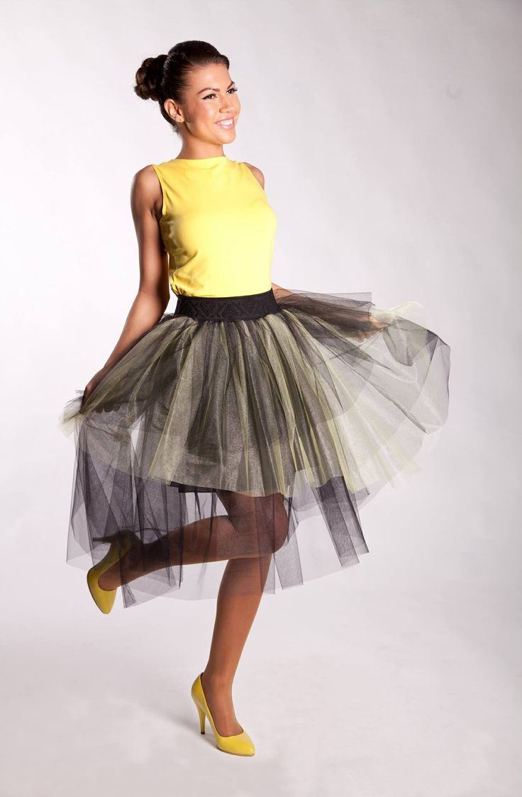 Cod Top: T1S14 Cod Fusta/Skirt: F1S14 Top din tricot, cu fundite pe spate si fusta din tul in doua culori. Knitted vest with bows on the back and tulle skirt in two colors. Model: Madalina Buftea Pantofi/Shoes: I Do shoes © Copyright - All Rights Reserved Moenra