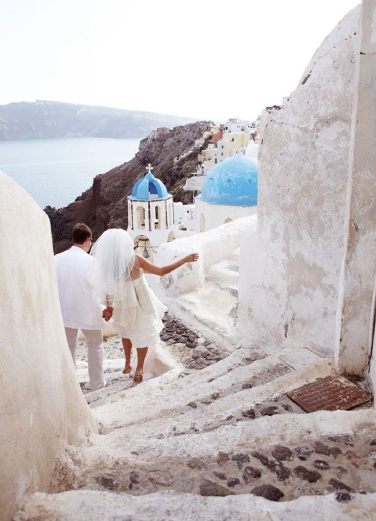 The newly weds, ready for action. Oia village, Santorini island, Greece - Selected by www.oiamansion.com