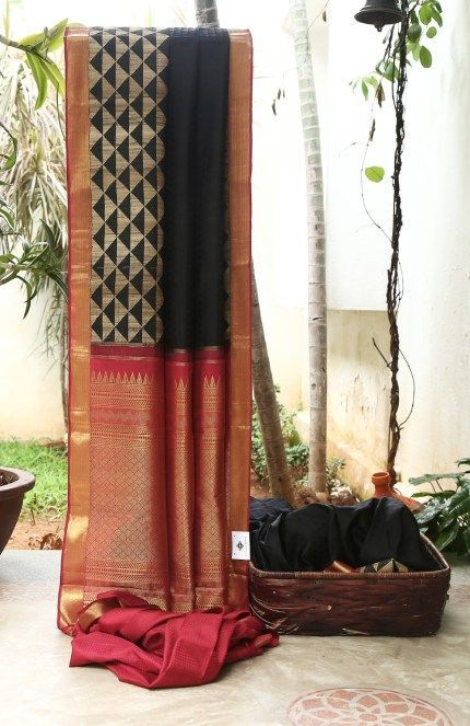 GLAMOURS BLACK GEOMETRIC BROCADE HAS BEIGE WITH BLACK AND CLASSIC MAROON WITH GOLD BORDER AND PALLU GIVING THE SAREE BEWITCHING FINISH.