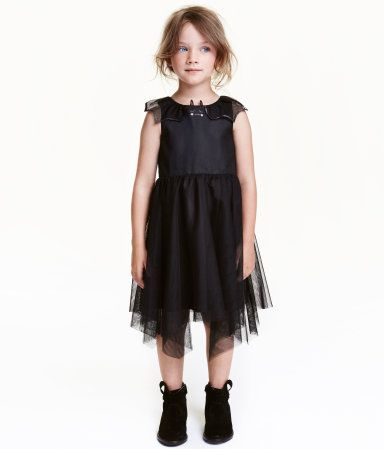 Check this out! Sleeveless dress in tulle with appliqués at neckline. Concealed fastening at back, seam at waist, and an asymmetric skirt. Lined. - Visit hm.com to see more.