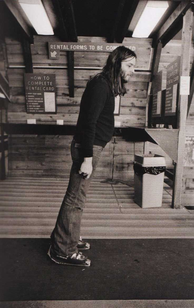David Gilmour of Pink Floyd trying out some ski boots, 1975