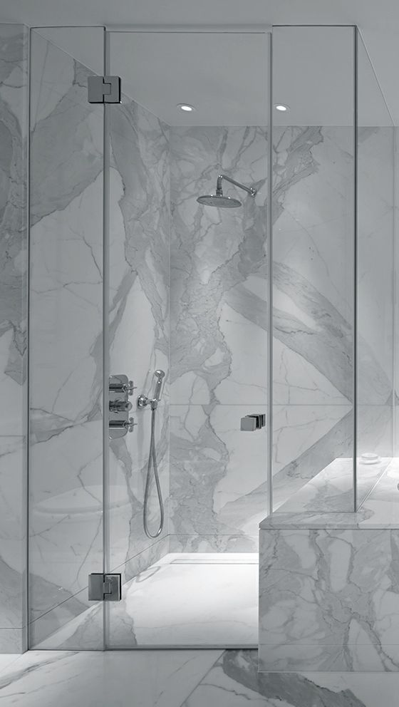 marble surround and flow into shower seat, frameless glass shower walls