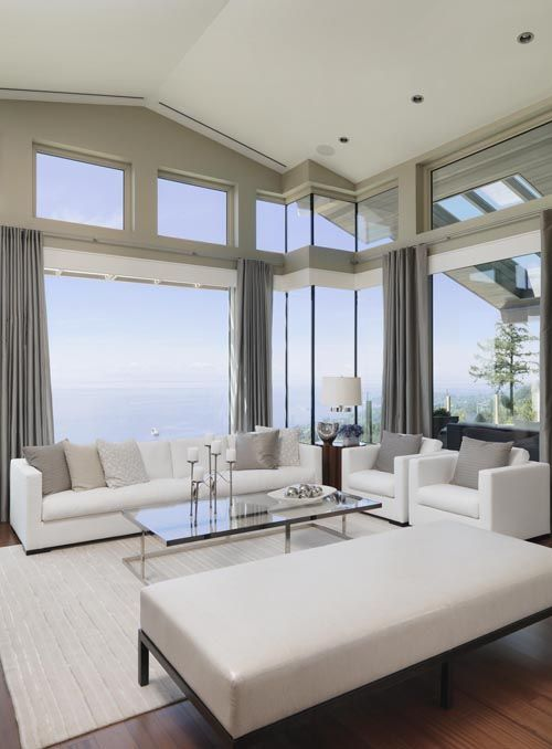 Clean and contemporary living room {British Pacific Homes} with wonderful, unique window corner.