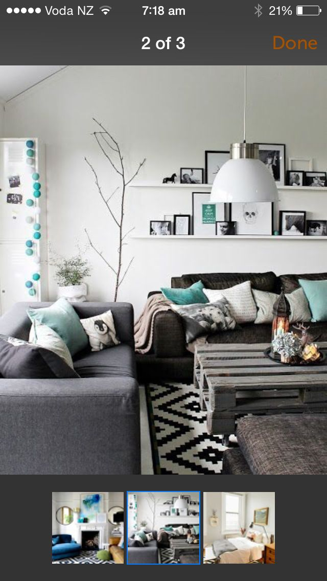 Love the turquoise mixed with the black and white rug. So bold