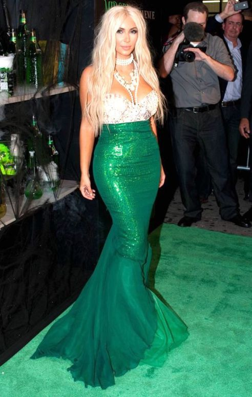Kim Kardashian mermaid skirt costume with bustier. Celebrity halloween costumes under $35 for women. Great party idea. Show up in style. Add extensions to get the hair. Check the tutorial.