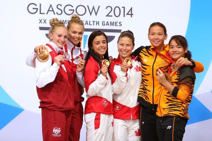 L-R) Silver medalists Sarah Barrow and Tonia Couch of England, gold medalists Meaghan Benfeito and Roseline Filion of Canada and bronze medalists Pandelela Rinong Pamg and Nur Dhabbitah Sabri of Malaysia