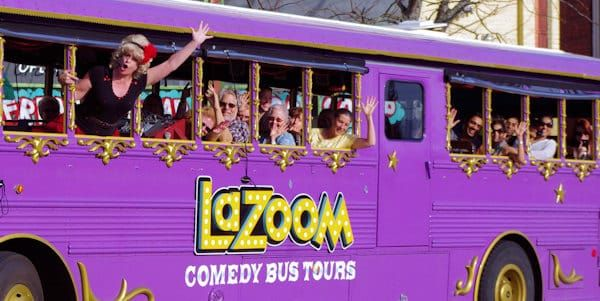 "New! Kid's Comedy Tour on the LaZoom big purple bus in Asheville NC with the famously outlandish tour guides.  Created for 5 to 12 year olds, this wacky family entertainment is a blend of Asheville history and kid-centric comedy for the 60 minute bus tour.  ""It's a show on wheels!""  (Romantic Asheville photo) Tickets $16 for ages 4 and up.  It's best to make reservations.  (828) 225-6932 Tour leaves at 90 Biltmore Avenue in downtown Asheville. lazoomtours.com/tours/kids-comedy-tour/"