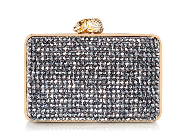 A gorgeous Flora Diamond box clutch bag from Wilbur & Gussie. This bag has been beautifully designed with faceted-crystal beads hand-sewn on to the front and back. Bag has a crystal encrusted rabbit fastening, optional gold chain and inner credit card pocket. View more bags from our Wilbur & Gussie Collection at: http://www.baroqueboutique.co.uk/wedding-shoes-and-accessories/