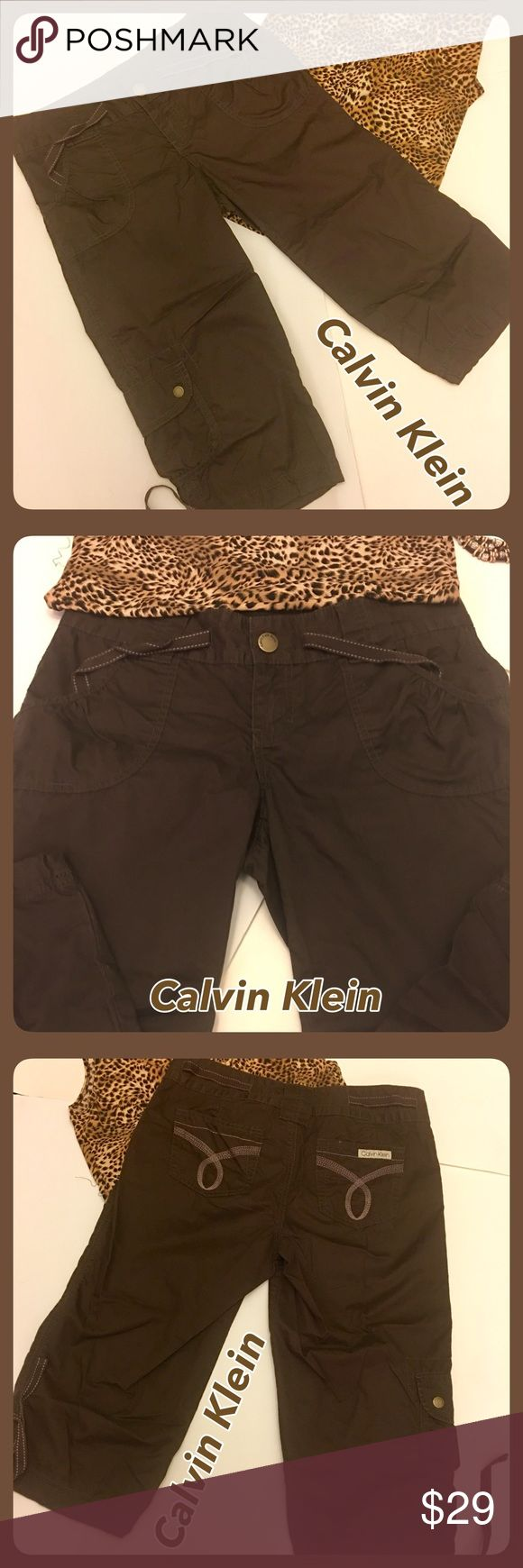 Calvin Klein Crop Brown Cotton Pants size 6 Very cute! Brown Calvin Klein Crop pants with tie at bottom of legs. Back pockets, front pockets. Cute pocket on bottom of right leg. Like New! Says 6P, but I don't see a difference in 6P & regular. Will provide measurements! Calvin Klein Pants Ankle & Cropped
