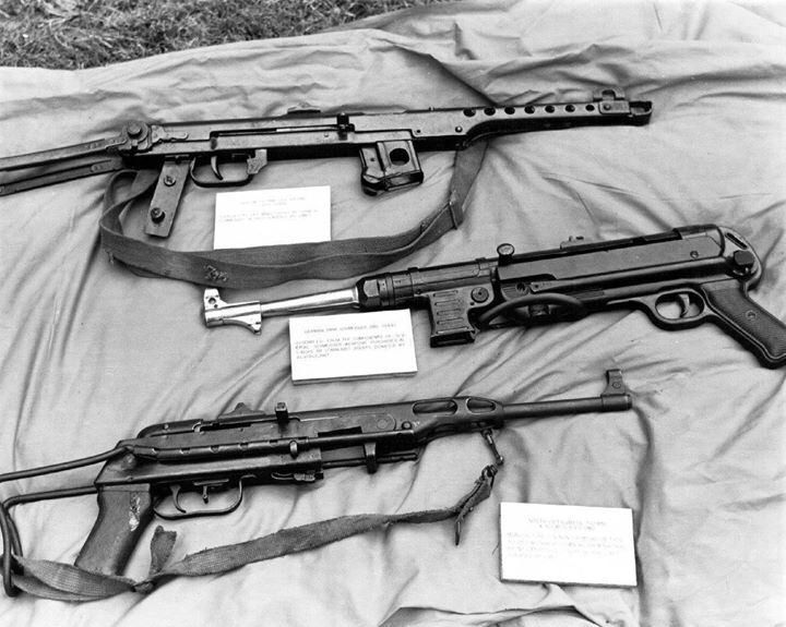 Submachine guns captured by US troops from the North Vietnamese Army, 1960 - Soviet PPS-43, German MP 40, and Vietnamese K-50M.