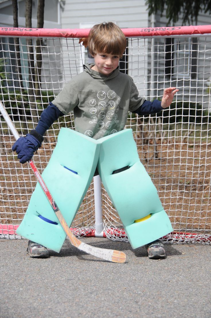 Homemade road hockey goalie pads tied on with sriing