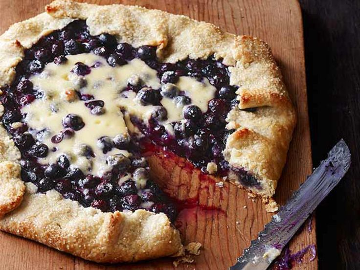 Blueberry Cheesecake Galette : Try this alternative to cheesecake made with flaky pastry dough, sweet cream cheese and bursting blueberries for a Labor Day dessert that can be sliced and served to a crowd.
