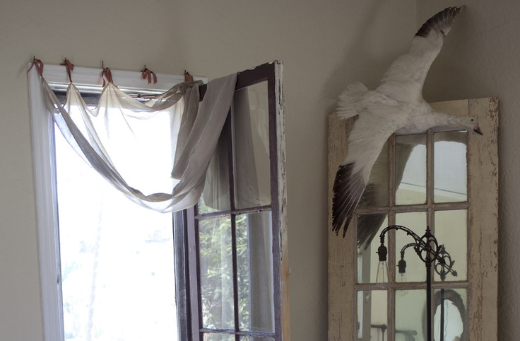 idea for hanging curtains on my French door windows.