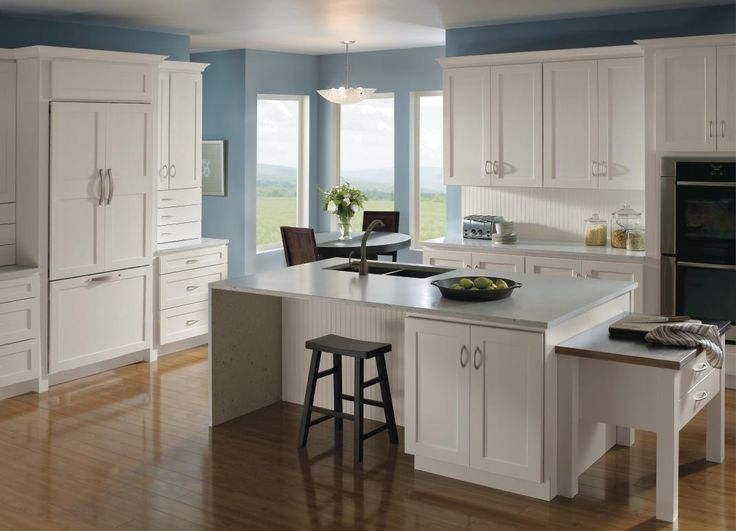 There's a reason white cabinets are a timeless choice. Homecrest's Dover Cabinets in an Alpine finish are the perfect example for a refreshing kitchen. #HomecrestKitchens