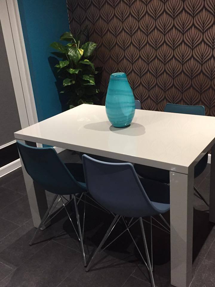 High Gloss dining Table with Teal and Steel Blue and Chrome dining Chairs