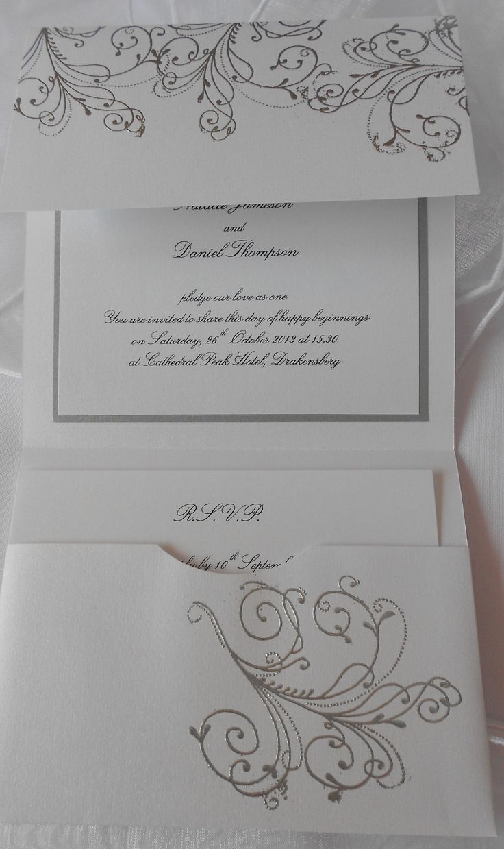 White and silver wedding invitation with heat embossing