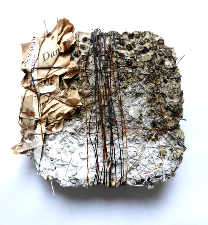 One. concrete, book pages and other material. Ines Seidel