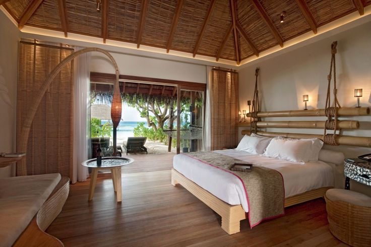 Bedroom with White Pillows and Soft Brown Wooden Floor