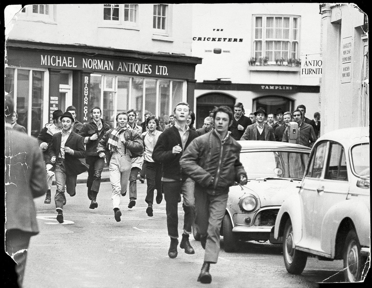 Football fans running through Brighton's Lanes in March 1970, Brighton, UK. Photograph by Bill Cross (Daily Mail / Rex Features).