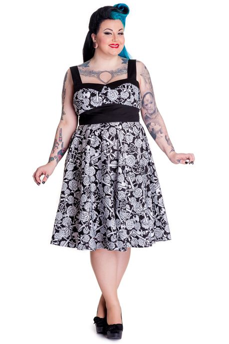 Hell Bunny Arcadia Plus Size 50's Dress. Printed 50's style dress. Fabric-cotton with lycra. Print-skulls, roses, bones, keys and heart locks. Seams over bust for shaping. Full circle skirt. 3 black covered buttons. Black cotton straps with buttons/buttonholes at the back to adjust. Black cotton waistband. Zip in center back seam. You will definitely turn heads in this dress ladies! Arcadia comes in 3 sizes: 2XL - UK size 18 3XL - UK size 20 4XL - UK size 22
