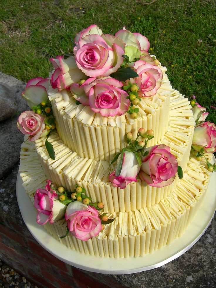 Chocolate wedding cake layered with a Belgian chocolate ganache.  Decorated with fresh summer flowers.