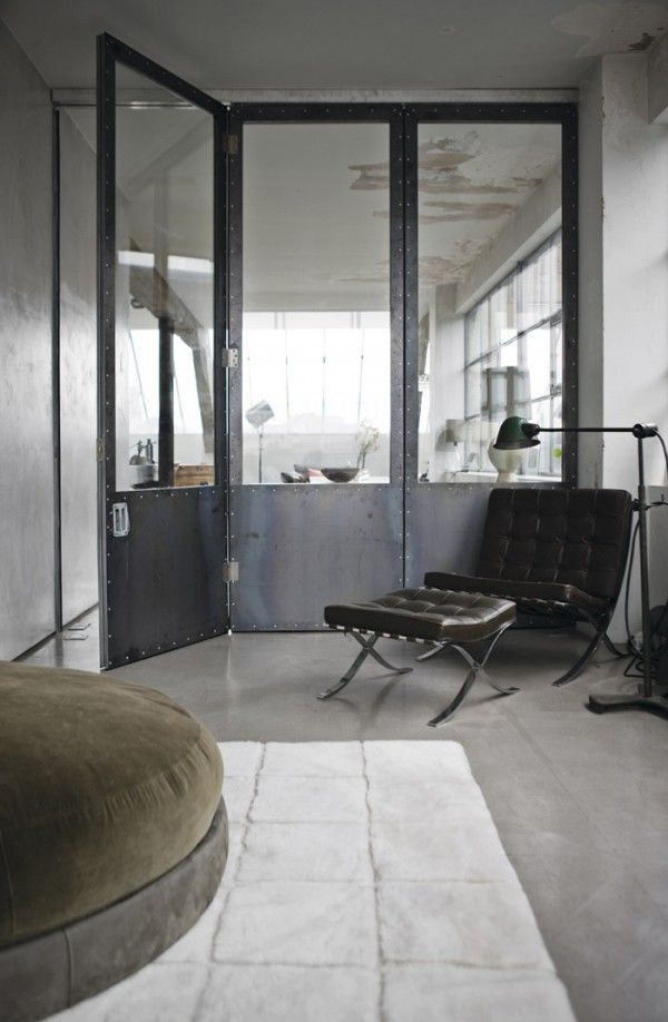The iconic Barcelona Chair fits in beautifully with its industrial surroundings. Via Trendland. www.nest.co.uk/search/knoll-barcelona-chair