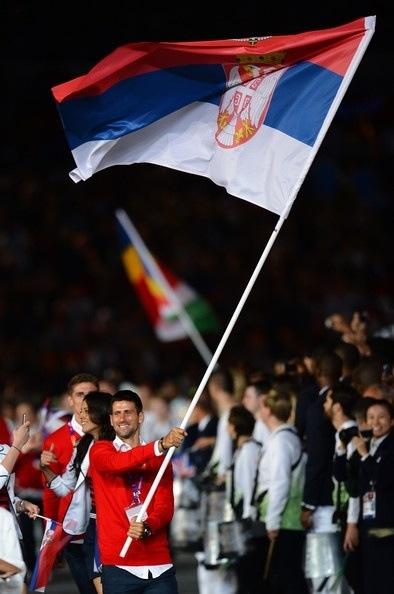 Tennis god waving the Serbian flag <3