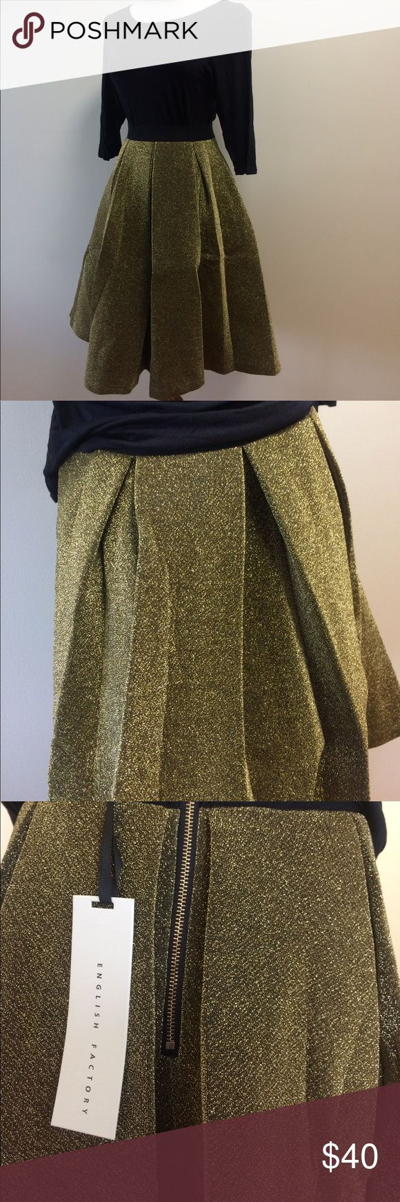 Metallic Gold Thread Holiday Circle Skirt Retro Gorgeous FULL circle skirt with metallic gold thread. No glitter falling off while you dance the night away. Fabric similar to neoprene, waistband stretchy (Small is on typical  medium size 6 mannequin.) back zipper. Large missing tag. Made  by English Factory sold on Unique Vintage and other similar sites.  💖 I consider ALL offers 💖 Skirts Circle & Skater