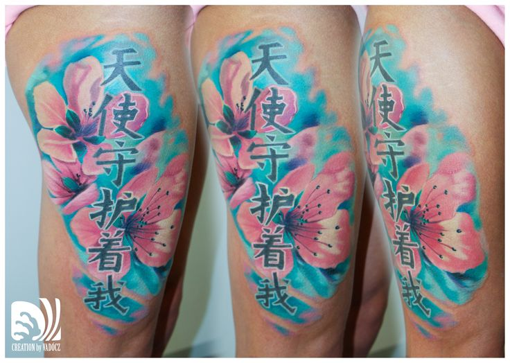 Cherry blossom tattoo large scale flowers oriental realistic artistic colour tattoo by Balázs Vadócz at Creation Tattoo Shop Budapest