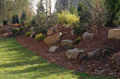 Hill landscape landscaping pinterest gardens north for Landscaping a hill with rocks