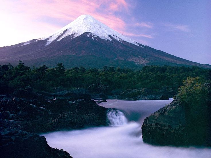 Petrohué Falls, Chile    Photograph by George F. Mobley    The gentle falls of the Petrohué River frame the graceful slopes of Osorno Volcano, part of the Andes Mountain. The scene is but one memorable view within Chile's Vicente Perez Rosales National Park.