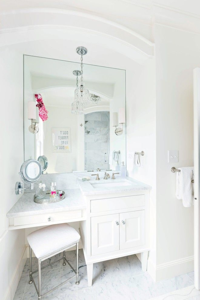 small vanity with sink and makeup area with white granite top, white cabinet under, large mirror, round retractable makeup mirror, crystal pendant of Makeup Area in Vanity to Treat a Lady Right